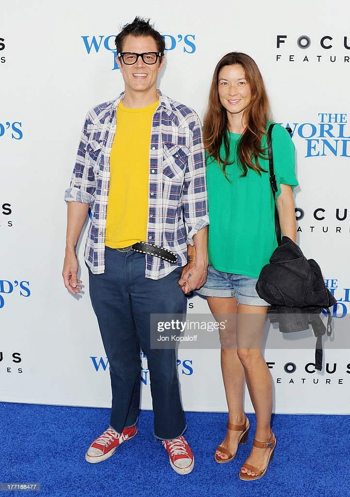 Actor Johnny Knoxville and wife Naomi Nelson arrive at the Los Angeles Premiere 'The World's End' at ArcLight Cinemas Cinerama Dome on August 21, 2013 in Hollywood, California.