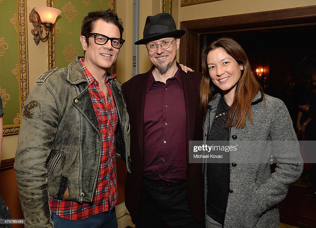 Actor Johnny Knoxville, artist Mark Ryden, and Naomi Nelson attend the Dom Perignon Reception after The Un-Private Collection: Jeff Koons and John Waters in Conversation at Orpheum Theatre on February 24, 2014 in Los Angeles, California.