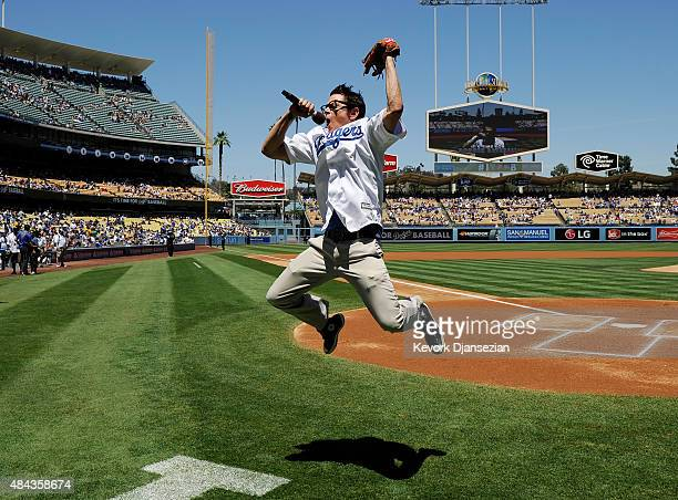 Actor Johnny Knoxville speaks to the crowd after throwing the ceremonial first pitch prior to the start of the baseball a game between the Los...