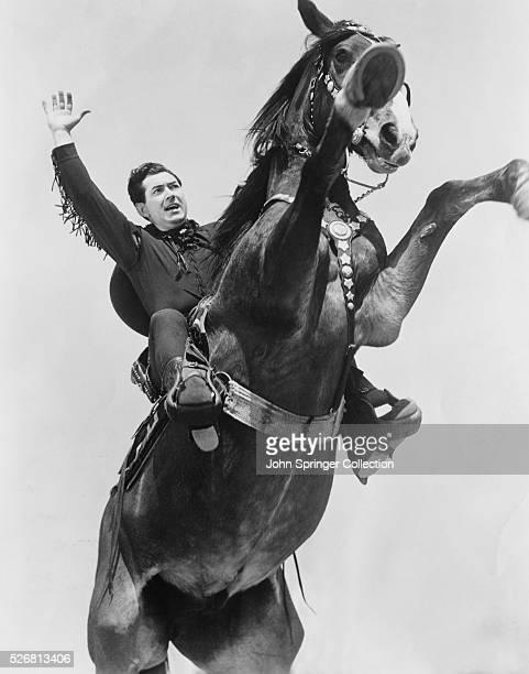Actor Johnny Mack Brown on Horseback
