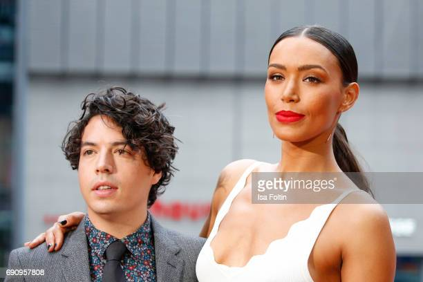 Actor Jon Bass and US actress Ilfenesh Hadera attend the 'Baywatch' Photo Call in Berlin on May 30 2017 in Berlin Germany