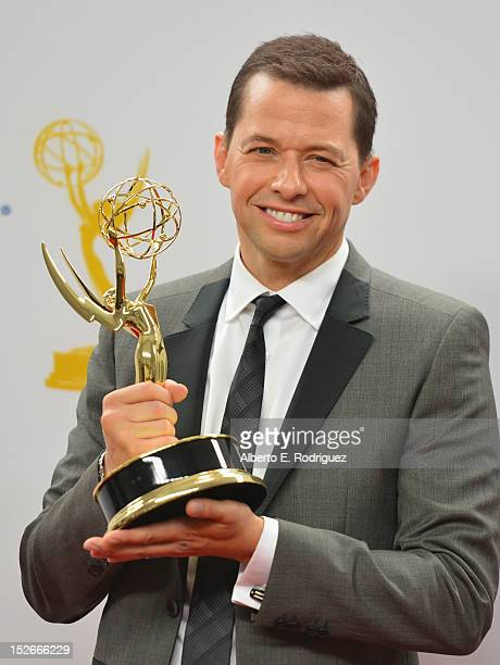 Actor Jon Cryer poses in the 64th Annual Emmy Awards press room at Nokia Theatre LA Live on September 23 2012 in Los Angeles California