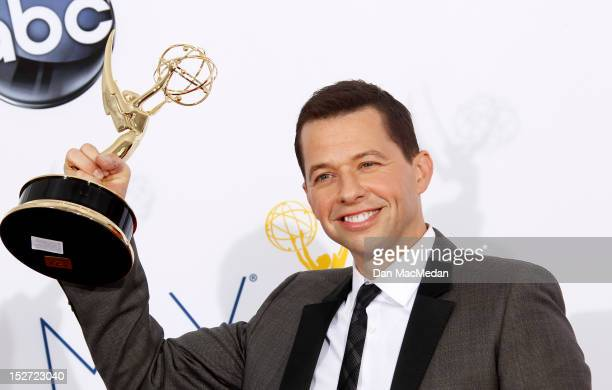Actor Jon Cryer poses in the press room at the 64th Primetime Emmy Awards held at Nokia Theatre LA Live on September 23 2012 in Los Angeles California
