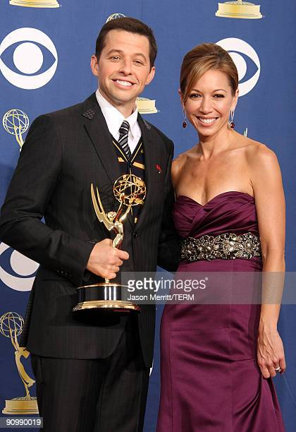 Actor Jon Cryer wife Lisa Joyner pose in the press room with Cryer's Emmy for Best Supporting Actor in a Comedy Series for 'Two And A Half Men' at...