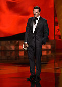 Actor Jon Hamm accepts Outstanding Lead Actor in a Drama Series award for 'Mad Men' onstage during the 67th Annual Primetime Emmy Awards at Microsoft...
