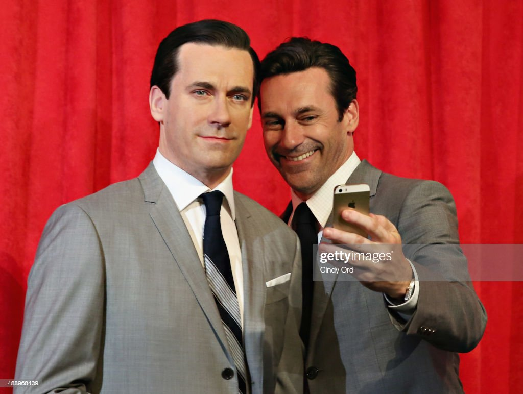 Actor Jon Hamm takes a selfie as he unveils Don Draper's wax figure during Mad Men's Final Season at Madame Tussauds New York on May 9, 2014 in New York City.