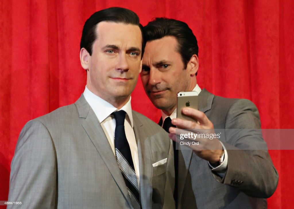 Actor Jon Hamm takes a selfie as he unveils Don Draper's wax figure during Mad Men's Final Season at Madame Tussauds New York on May 9 2014 in New...