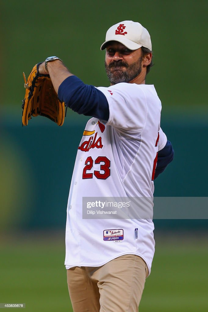 Actor <a gi-track='captionPersonalityLinkClicked' href=/galleries/search?phrase=Jon+Hamm&family=editorial&specificpeople=3027367 ng-click='$event.stopPropagation()'>Jon Hamm</a> throws out the ceremonial first pitch prior to a game between the St. Louis Cardinals and the Cincinnati Reds at Busch Stadium on August 18, 2014 in St. Louis, Missouri.