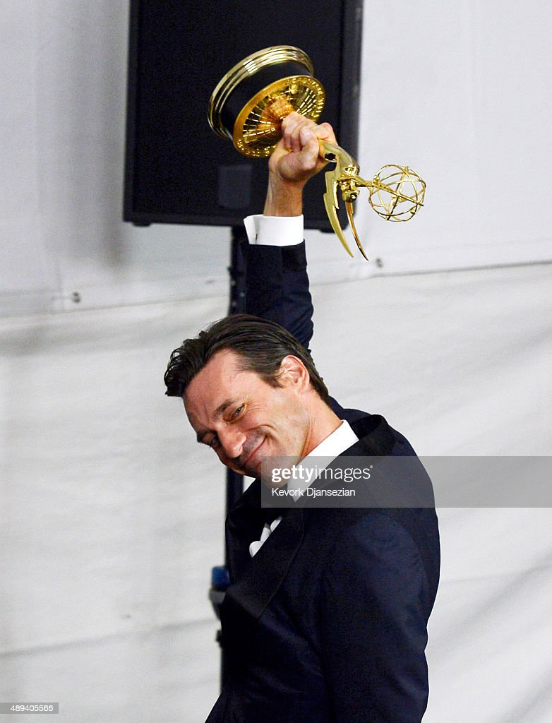 Actor Jon Hamm winner of Outstanding Lead Actor in a Drama Series for 'Mad Men' reacts as he holds up the Emmy Award as he walks out of the press...