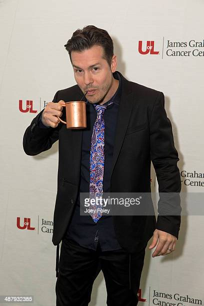 Actor Jon Seda jokes around on the red carpet as he attends the 2014 Julep Ball at KFC YUM Center on May 2 2014 in Louisville Kentucky