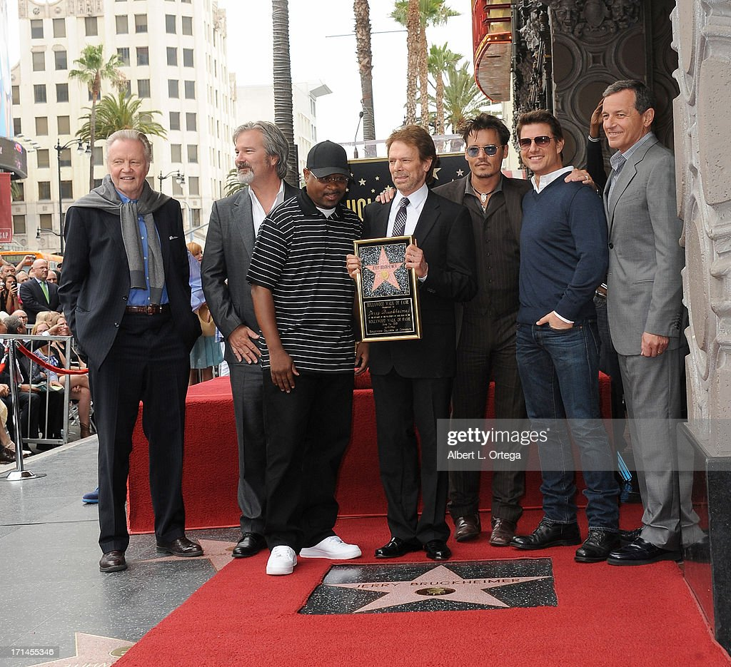 Actor Jon Voight, director Gore Verbinski, actor Martin Lawrence, producer Jerry Bruckheimer, actor Johnny Depp, actor Tom Cruise and Disney executive Bob Iger attend the Jerry Bruckheimer Star On The Hollywood Walk Of Fame on June 24, 2013 in Hollywood, California.