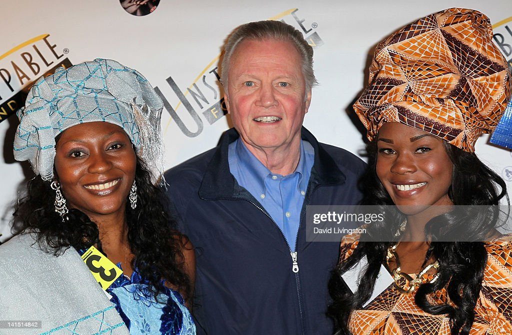 Actor <a gi-track='captionPersonalityLinkClicked' href=/galleries/search?phrase=Jon+Voight&family=editorial&specificpeople=202872 ng-click='$event.stopPropagation()'>Jon Voight</a> (C) poses on the red carpet at the 3rd annual Unstoppable Gala at the Millennium Biltmore Hotel on March 17, 2012 in Los Angeles, California.