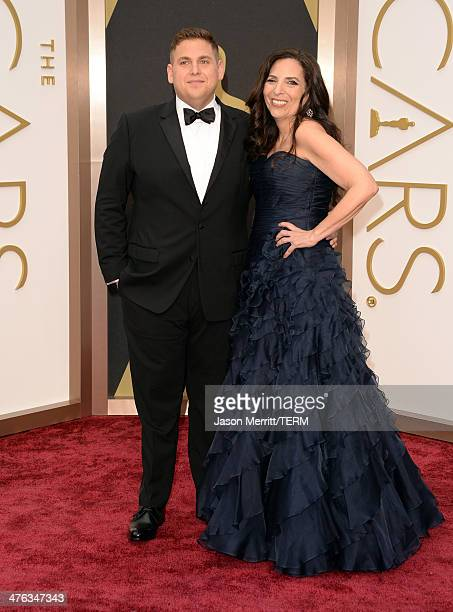 Actor Jonah Hill and Sharon Lyn Chalkin attends the Oscars held at Hollywood Highland Center on March 2 2014 in Hollywood California