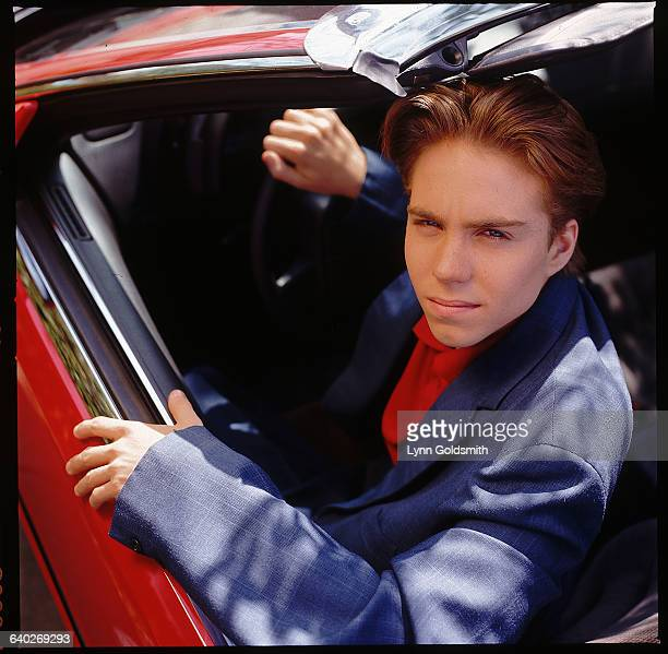 5/1994 Actor Jonathan Brandis star of the television show 'SeaQuest DSV' looks back from the driver's seat of a red convertable sports car He is...