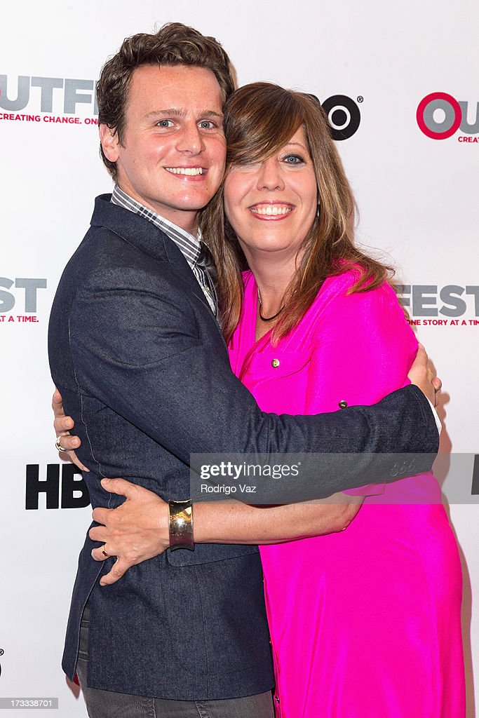 Actor Jonathan Goff and Outfest Executive Director Kirsten Schaffer arrive at the 13th Annual Outfest Opening Night Gala Of 'C.O.G.' at Orpheum Theatre on July 11, 2013 in Los Angeles, California.