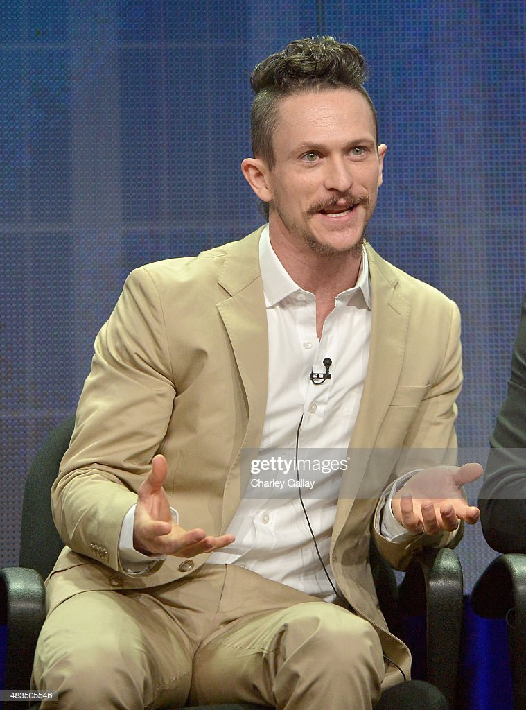 Actor Jonathan Tucker speaks onstage during the DIRECTV's presentation of KINGDOM at the 2015 Summer TCA Press Tour at The Beverly Hilton Hotel on...