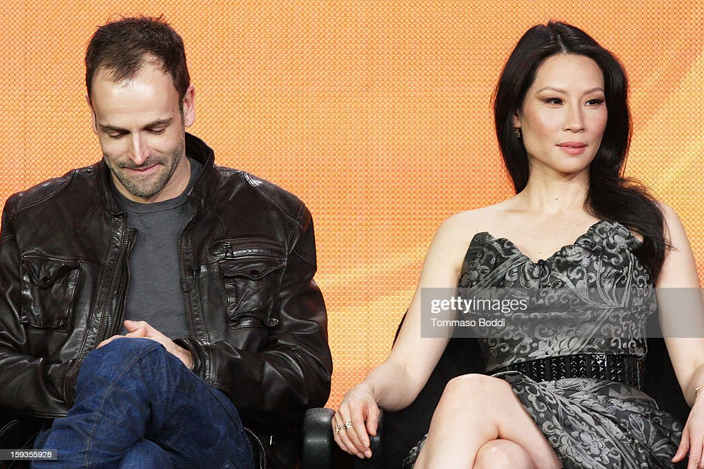 Actor Jonny Lee Miller (L) and actress Lucy Liu of the TV show 'Elementary' attend the 2013 TCA Winter Press Tour CW/CBS panel held at The Langham Huntington Hotel and Spa on January 12, 2013 in Pasadena, California.