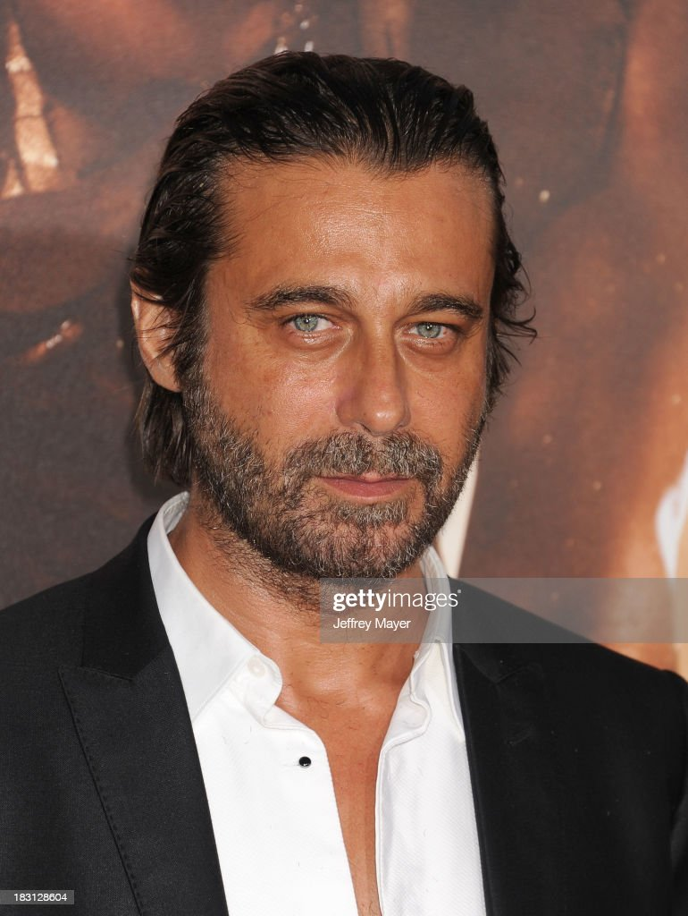 Actor Jordi Molla arrives at the Los Angeles premiere of 'Riddick' at the Westwood Village Theatre on August 28, 2013 in Westwood, California.