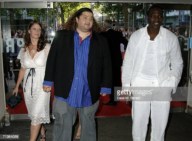 Actor Jorge Garcia his girlfriend Malia Hansen and actor Adewale AkinnuoyeAgbaje arrive at the European Premiere of 'Pirates Of The Caribbean Dead...