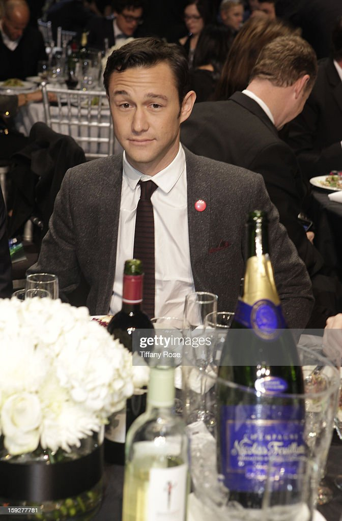 Actor <a gi-track='captionPersonalityLinkClicked' href=/galleries/search?phrase=Joseph+Gordon-Levitt&family=editorial&specificpeople=213632 ng-click='$event.stopPropagation()'>Joseph Gordon-Levitt</a> attends the Critics' Choice Movie Awards 2013 with Champagne Nicolas Feuillatte at Barkar Hangar on January 10, 2013 in Santa Monica, California.