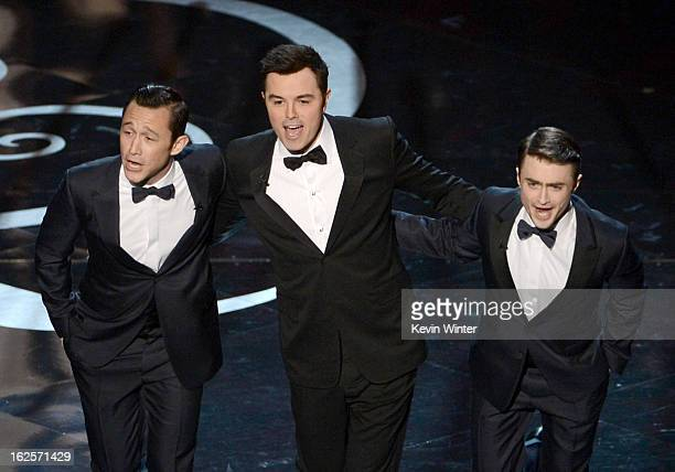 Actor Joseph GordonLevitt host Seth MacFarlane and actor Daniel Radcliffe dance onstage during the Oscars held at the Dolby Theatre on February 24...
