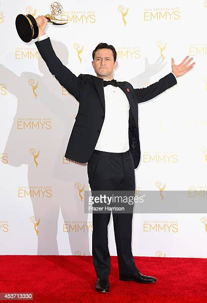 Actor Joseph GordonLevitt poses in the press room during the 2014 Creative Arts Emmy Awards at Nokia Theatre LA Live on August 16 2014 in Los Angeles...