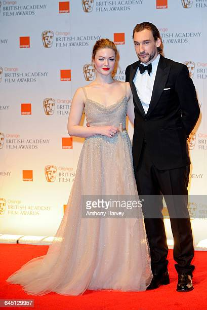 Actor Joseph Mawle and actress Holliday Grainger in the press room during 2012 Orange British Academy Film Awards at The Royal Opera House on...