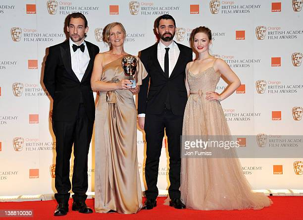 Actor Joseph Mawle and filmmakers Sue Goffe and Grant Orchard and actress Holliday Grainger pose in the press room with the Short Animation award...