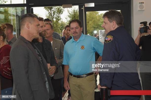 Actor Josh Brolin singersongwriter Dierks Bently and two of Nashville's firemen attends 'Only The Brave' Nashville screening hosted by Dierks Bentley...