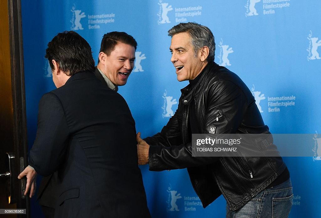 US actor Josh Brolin, US actor Channing Tatum and US actor George Clooney joke during the photo call for the film 'Hail, Caesar!' screened as opening film of the 66th Berlinale Film Festival in Berlin on February 11, 2016. The 66th Berlin film festival starts on February 11, 2016 with a spotlight on Europe's refugee crisis. / AFP / TOBIAS SCHWARZ