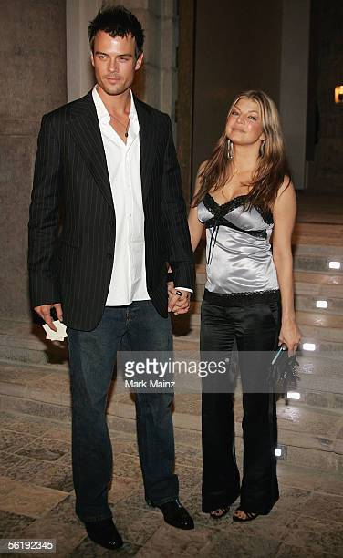 Actor Josh Duhamel and Fergie of Black Eyed Peas attends the 'Gucci Spring 2006 Fashion Show Benefitting The Childrens Action Network' at Michael...