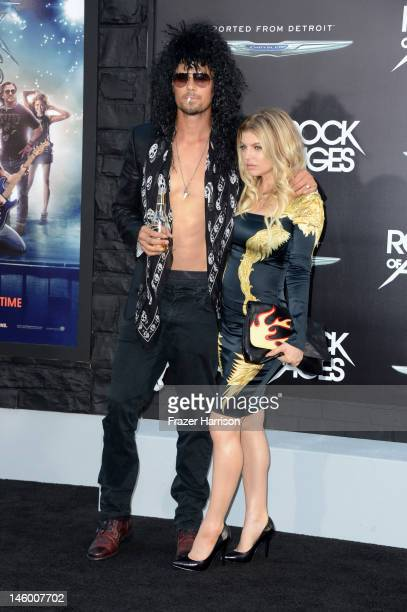 Actor Josh Duhamel and singer Fergie arrive at the premiere of Warner Bros Pictures' 'Rock of Ages' at Grauman's Chinese Theatre on June 8 2012 in...
