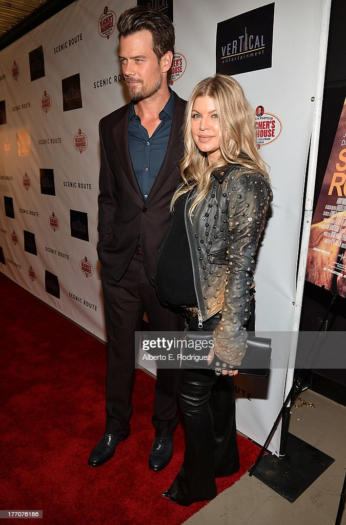 Actor Josh Duhamel (L) and singer/actress Fergie arrive at the premiere of Vertical Entertainment's 'Scenic Route' at Chinese 6 Theater- Hollywood on August 20, 2013 in Hollywood, California.