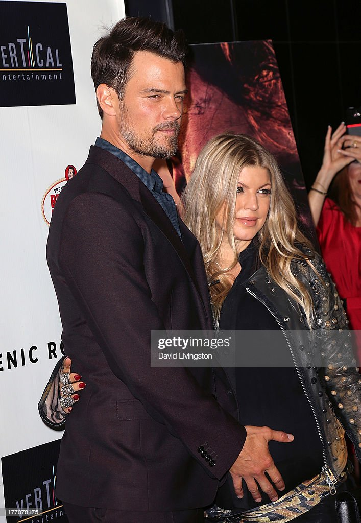 Actor Josh Duhamel (L) and wife recording artist Fergie Duhamel attend the premiere of Vertical Entertainment's 'Scenic Route' at the Chinese 6 Theaters Hollywood on August 20, 2013 in Hollywood, California.