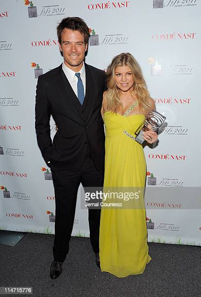 Actor Josh Duhamel poses with singer Fergie backstage with the FiFi New Celebrity Fragrance of the Year Award at the 2011 FiFi Awards at The Tent at...
