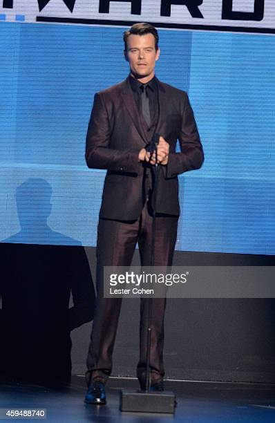 Actor Josh Duhamel speaks onstage at the 2014 American Music Awards at Nokia Theatre LA Live on November 23 2014 in Los Angeles California