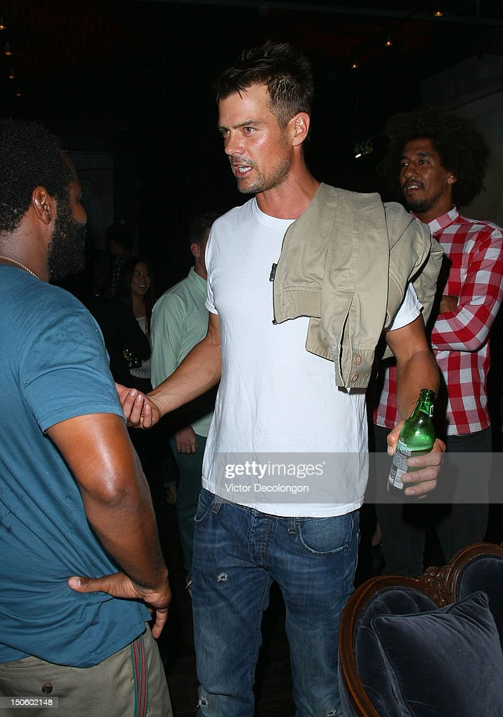 Actor Josh Duhamel talks to musician Selema Masakela after the screening of 'Alekesam' at Sonos Studio on August 22, 2012 in Los Angeles, California.