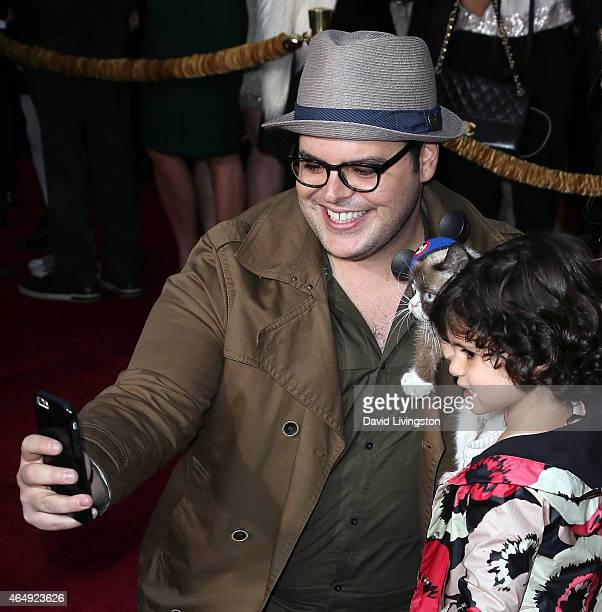 Actor Josh Gad takes a selfie with his daugher and Grumpy Cat at the premiere of Disney's 'Cinderella' at the El Capitan Theatre on March 1 2015 in...