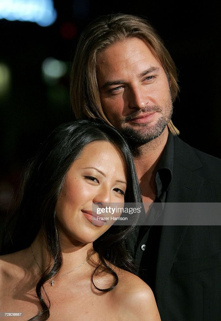 Actor Josh Holloway (R) and wife Yessica Kumala arrive at the Warner Bros. premiere of 'We Are Marshall' held at the Grauman's Chinese Theatre on December 14, 2006 in Hollywood, California.