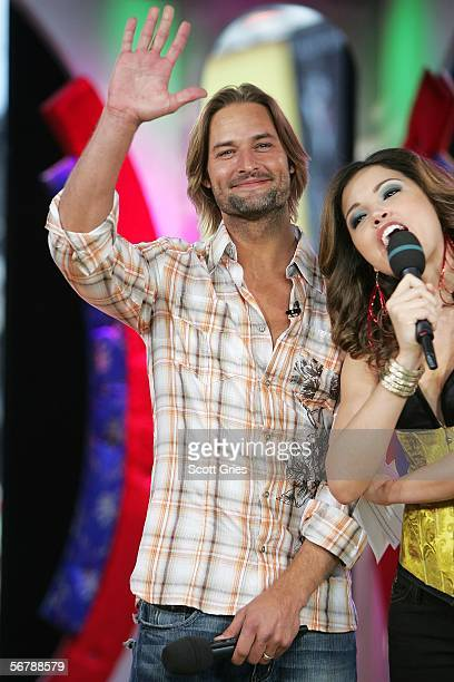 Actor Josh Holloway appears on stage with host Susie Castillo during MTV's Total Request Live at the MTV Times Square Studios on February 8 2006 in...