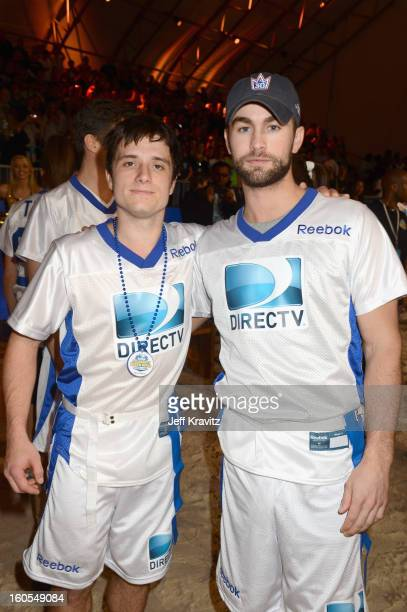 Actor Josh Hutcherson and actor Chace Crawford attend DIRECTV'S 7th Annual Celebrity Beach Bowl at DTV SuperFan Stadium at Mardi Gras World on...
