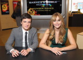 Actor Josh Hutcherson and actress Jennifer Lawrence attend a special signing event to promote their new movie 'The Hunger Games' at Barnes Noble...