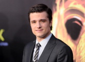 Actor Josh Hutcherson arrives at the premiere of Lionsgate's 'The Hunger Games' at Nokia Theatre LA Live on March 12 2012 in Los Angeles California