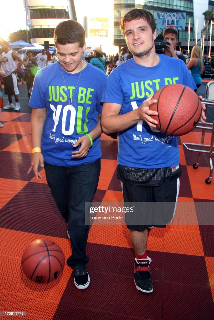 Actor Josh Hutcherson (R) attends the 5th annual Nike basketball 3ON3 tournament presented by NBC4 southern california held at L.A. LIVE on August 9, 2013 in Los Angeles, California.