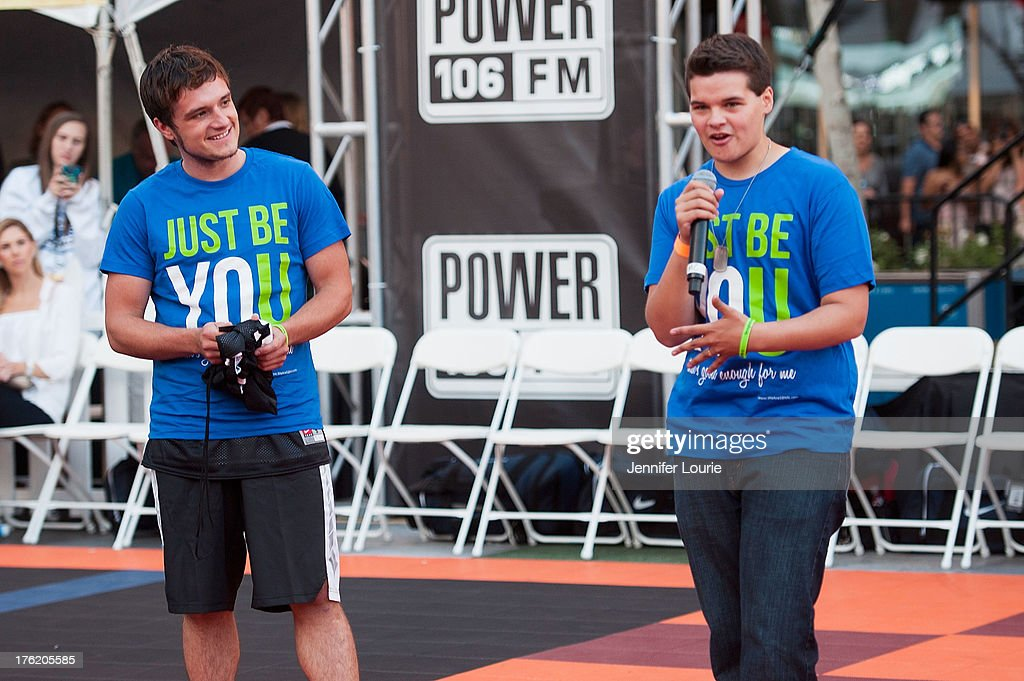 Actor Josh Hutcherson (L) attends the 5th annual Nike basketball 3ON3 tournament presented by NBC4 southern california held at L.A. LIVE on August 9, 2013 in Los Angeles, California.