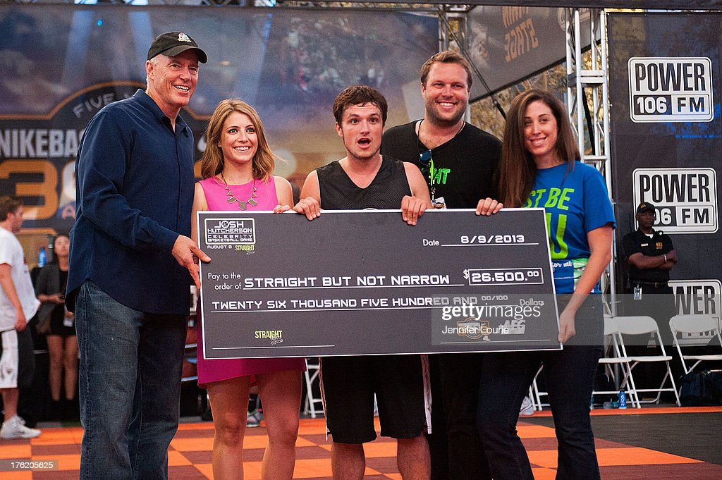 Actor Josh Hutcherson (C) attends the 5th annual Nike basketball 3ON3 tournament presented by NBC4 southern california held at L.A. LIVE on August 9, 2013 in Los Angeles, California.