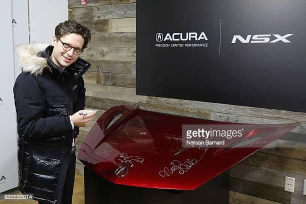 Actor Josh Kaye of 'Come Swim' signs the hood of a 2017 Acura NSX at the Acura Studio during Sundance Film Festival 2017 in Park City on January 20...