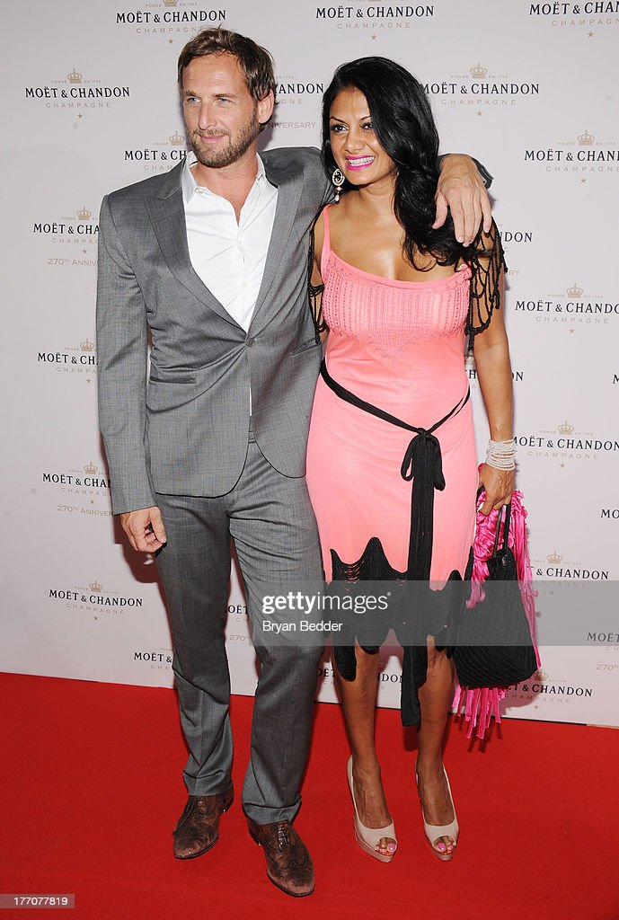 Actor Josh Lucas (L) and Donna D'Cruz attend Moet & Chandon Celebrates Its 270th Anniversary With New Global Brand Ambassador, International Tennis Champion, Roger Federer at Chelsea Piers Sports Center on August 20, 2013 in New York City.