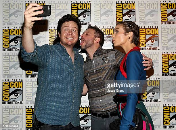 Actor Josh McDermitt TV host Chris Hardwick and actress Lauren Cohan during ComicCon International 2016 on July 22 2016 in San Diego California