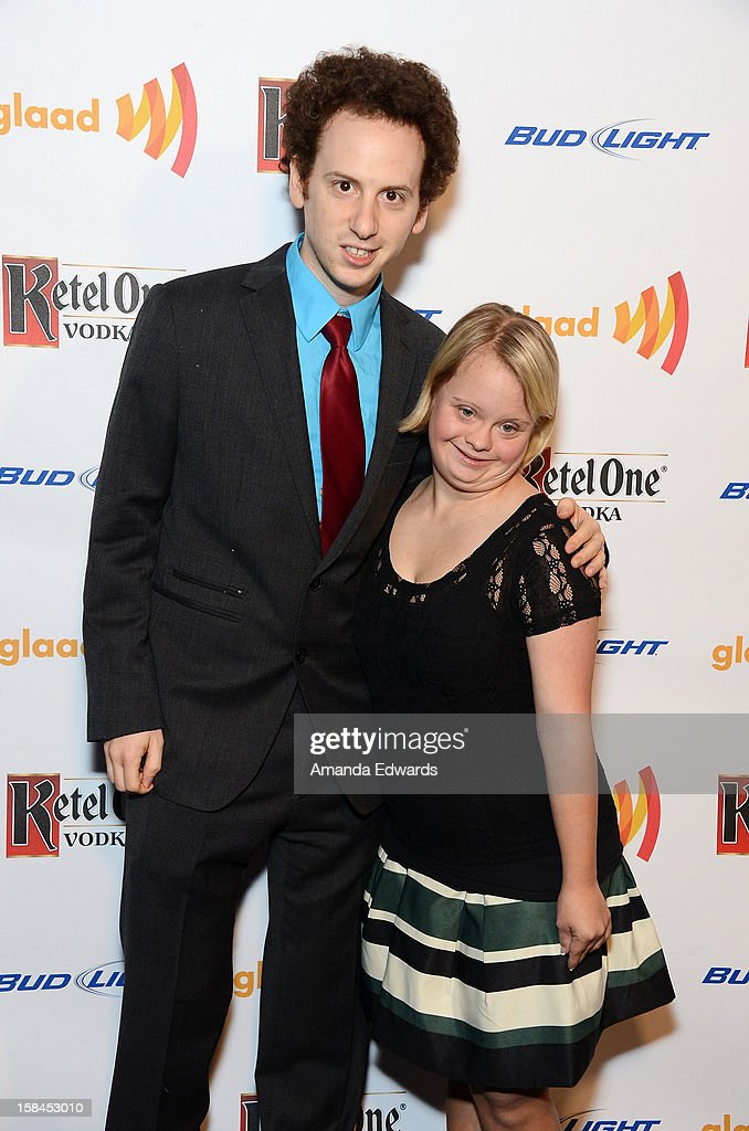Actor <a gi-track='captionPersonalityLinkClicked' href=/galleries/search?phrase=Josh+Sussman&family=editorial&specificpeople=5756661 ng-click='$event.stopPropagation()'>Josh Sussman</a> (L) and actress <a gi-track='captionPersonalityLinkClicked' href=/galleries/search?phrase=Lauren+Potter&family=editorial&specificpeople=7243163 ng-click='$event.stopPropagation()'>Lauren Potter</a> arrive at the GLAAD Tidings Annual Holiday Celebration at The London Hotel on December 16, 2012 in West Hollywood, California.